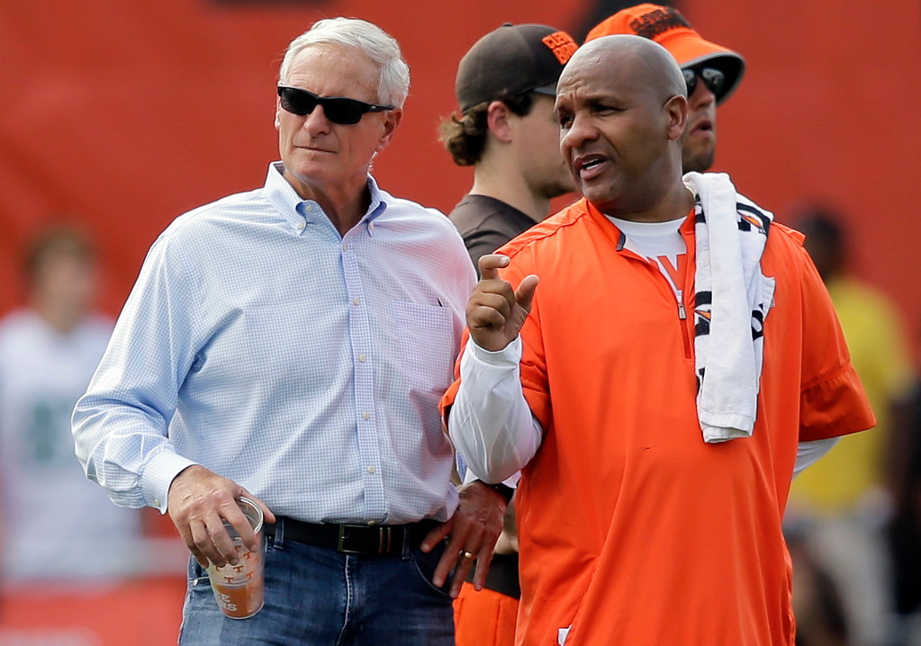 . Cleveland Browns owner Jimmy Haslam, left, nS coach Hue Jackson talk during practice at the NFL football team\'s training camp facility, Thursday, July 27, 2017, in Berea, Ohio. (AP Photo/Tony Dejak)