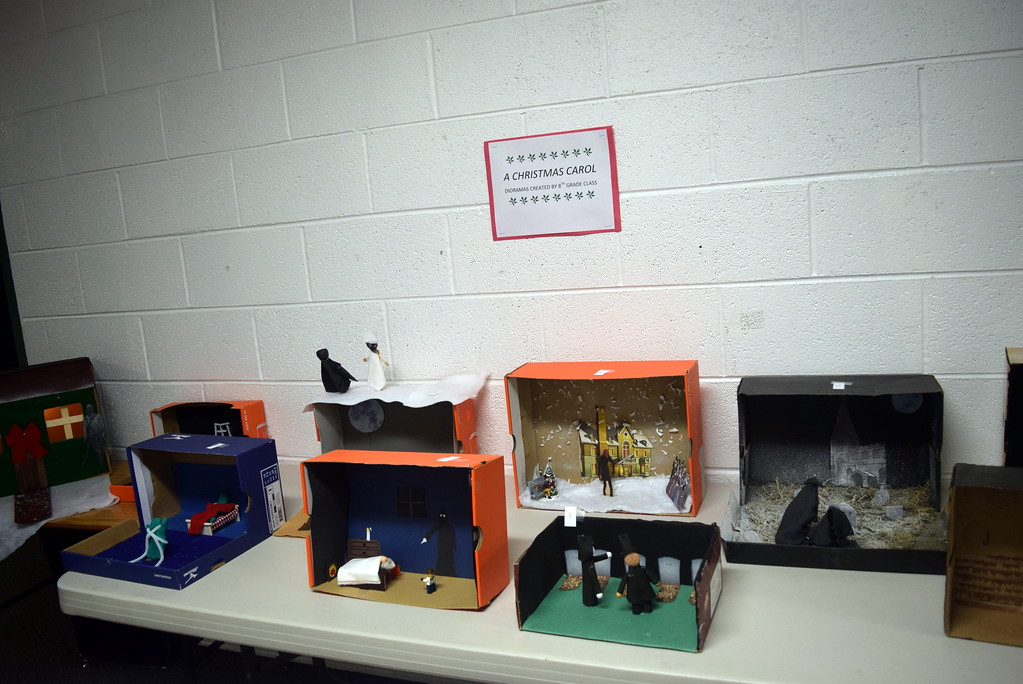 """. \""""A Christmas Carol\"""" dioramas created by eighth grade students at Fleming School were on display at the elementary holiday concert Monday, Dec. 11, 2017."""