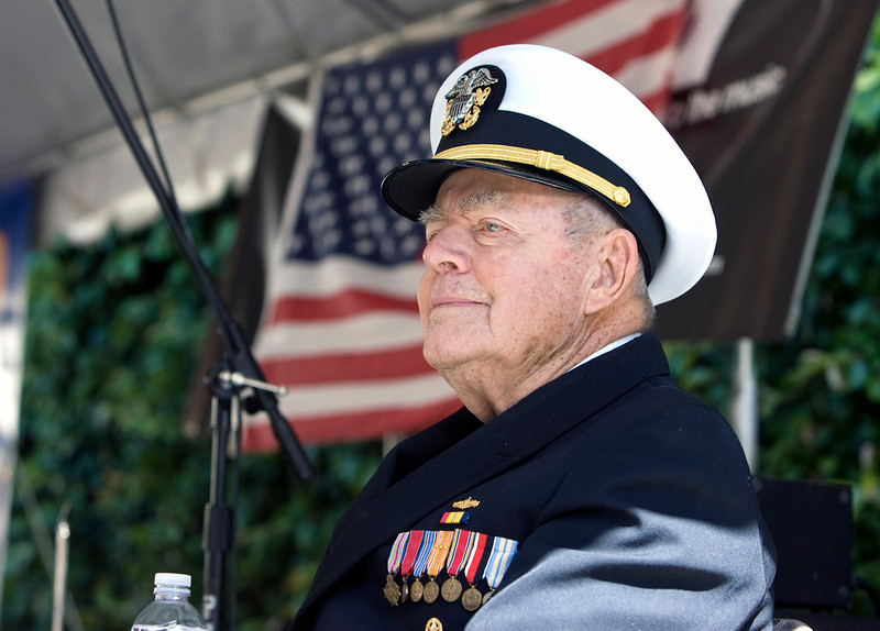 Lt. Commander Ted Robinson, USN (ret.) speaks at the Memorial Day Ceremony at the Sacramento Jazz Festival.