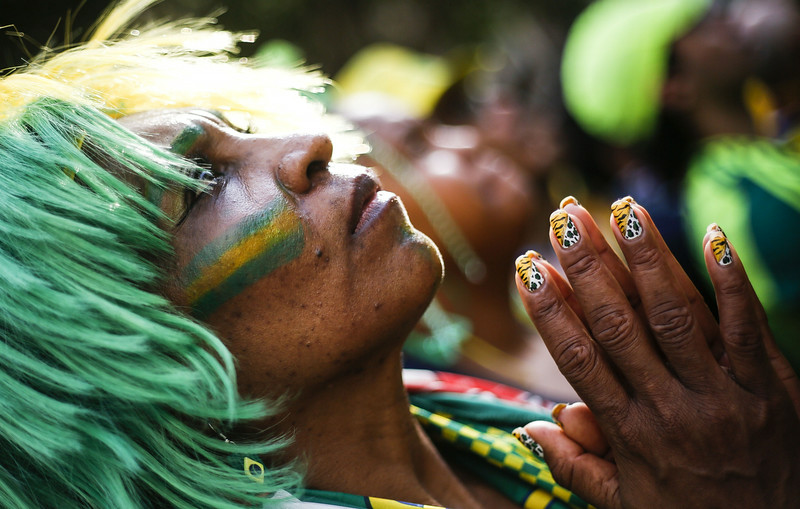 . Supporters of the Brazilian national football team attend the 2014 FIFA World Cup Brazil vs Chile, at the FIFA Fan Fest public viewing event in Sao Paulo, Brazil on June 28, 2014. (Miguel Schincariol/AFP/Getty Images)