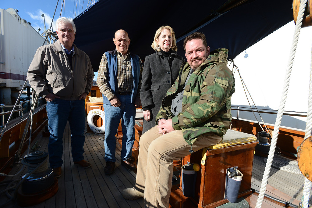 . Mike Conklin, left, and Jason Deitch, right, with Sentinels of Freedom, and ship owners and captains Bill and Grace Bodle are photographed aboard the Eros, a restored 1939 English schooner, in Richmond, Calif. on Thursday, Jan. 10, 2013. (Kristopher Skinner/Staff)