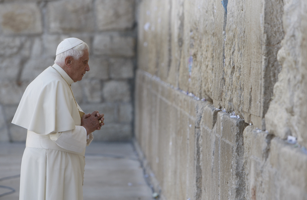 Description of . A file picture taken on May 12, 2009 shows Pope Benedict XVI praying at the Western Wall in Jerusalem's Old City. Pope Benedict XVI announced on February 11, 2013 he will resign on February 28 because his age prevented him from carrying out his duties, an unprecedented move in the modern history of the Catholic Church.  AFP PHOTO/POOL/RONEN ZVULUNRONEN ZVULUN/AFP/Getty Images