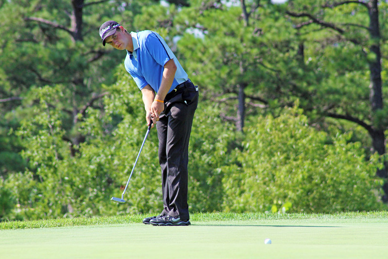 Patrick Rodgers watches his ball trickle down his line to the hole on the 17th green during the third round of the 2013 Western Amateur at The Alotian Club in Roland, AR. (WGA Photo/Ian Yelton)
