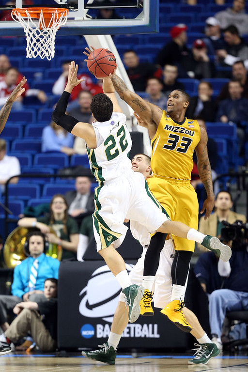 . LEXINGTON, KY - MARCH 21:  Dorian Green #22 of the Colorado State Rams goes to the hoop against Earnest Ross #33 of the Missouri Tigers during the second round of the 2013 NCAA Men\'s Basketball Tournament at the Rupp Arena on March 21, 2013 in Lexington, Kentucky.  (Photo by Andy Lyons/Getty Images)