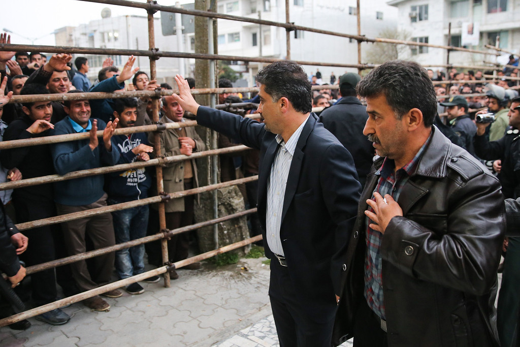 . Bystanders applaud Abdolghani Hosseinzadeh (R) the father of Abdolah, an Iranian youth killed by fellow national Balal in a street fight with a knife in 2007, after he and his wife pardoned their son\'s convicted murderer, during his execution ceremony in the northern city of Nowshahr on April 15, 2014.  AFP PHOTO/ARASH KHAMOOSHI/AFP/Getty Images