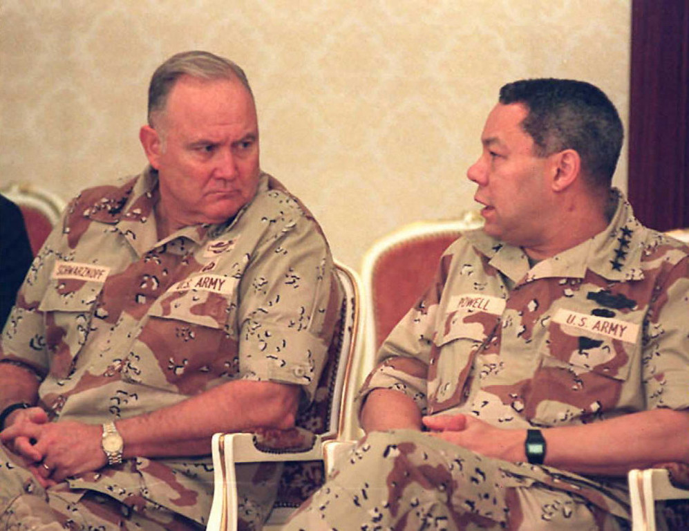 . Picture dated 23 Dec 90 of US Army General Norman Schwarzkopf (l) speaking with Commander of the U.S Forces in Saudi Arabia, General Colin Powell.         BOB SULLIVAN/AFP/Getty Images
