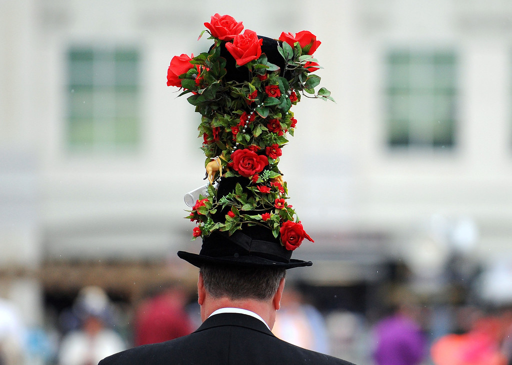 . LOUISVILLE, KY - MAY 04:  A race fan wearing a festive hat attends the 139th running of the Kentucky Derby at Churchill Downs on May 4, 2013 in Louisville, Kentucky.  (Photo by Jamey Price/Getty Images)