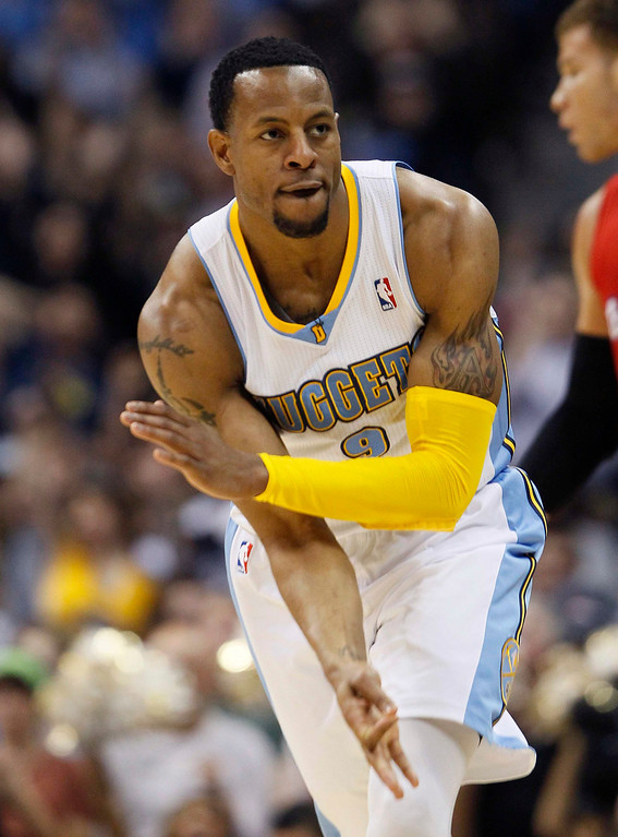 . Denver Nuggets\' Andre Iguodala signals after scoring a three-point shot over the Los Angeles Clippers in their NBA basketball game in Denver March 7, 2013. REUTERS/Rick Wilking
