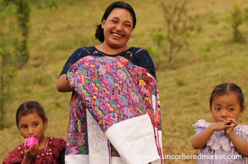 Kiva Borrower with Daughters - San Pedro Sacatepequez, Guatemala