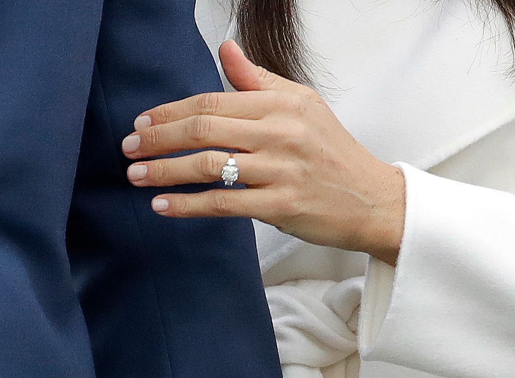 . Britain\'s Prince Harry\'s fiancee Meghan Markle shows off her engagement ring as she poses for photographers during a photocall in the grounds of Kensington Palace in London, Monday Nov. 27, 2017. Britain\'s royal palace says Prince Harry and actress Meghan Markle are engaged and will marry in the spring of 2018. (AP Photo/Matt Dunham)