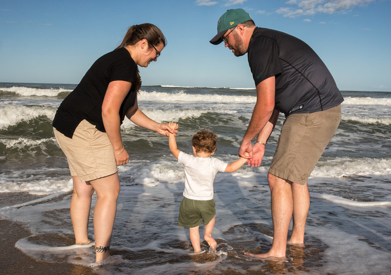 Jesse and Holly helping Caleb in the waves.jpg