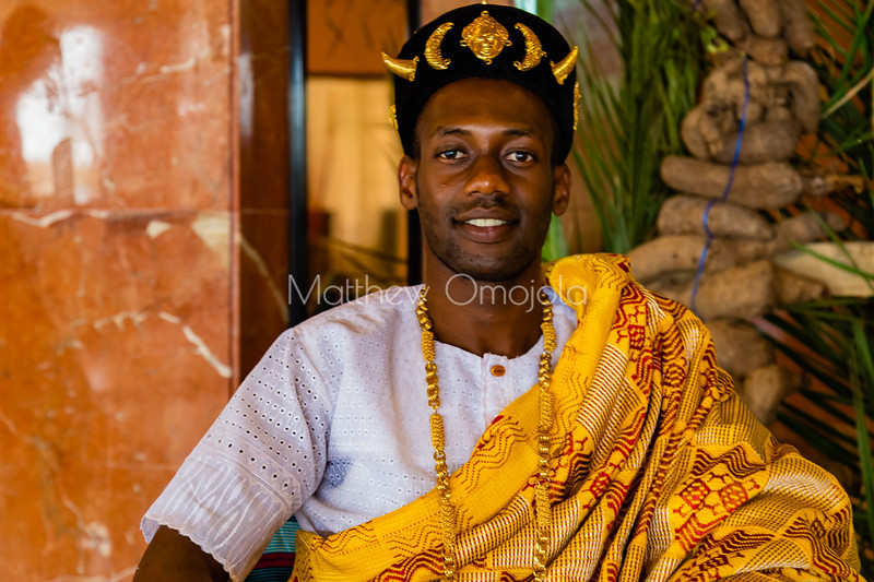 African ivorian culture on display at the president hotel Yamoussoukro. Young ivorian man wearing traditional african Ivorian dress with gold jewelry. Promoting culture. African cap decorated with gold.