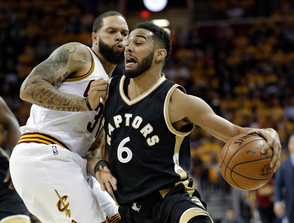 . Toronto Raptors\' Cory Joseph (6) drives past Cleveland Cavaliers\' Deron Williams (31) during the first half in Game 2 of a second-round NBA basketball playoff series, Wednesday, May 3, 2017, in Cleveland. (AP Photo/Tony Dejak)