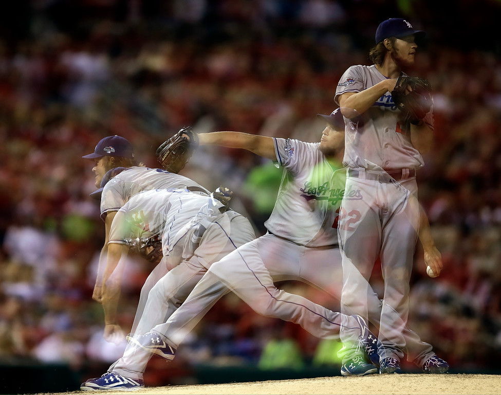. This multiple exposure photo shows Los Angeles Dodgers starting pitcher Clayton Kershaw throwing during the second inning of Game 6 of the National League baseball championship series against the St. Louis Cardinals, Friday, Oct. 18, 2013, in St. Louis. (AP Photo/Jeff Roberson)