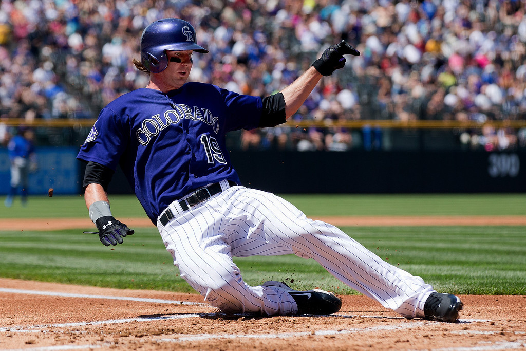. Charlie Blackmon #19 of the Colorado Rockies slides in to score during the first inning against the Chicago Cubs at Coors Field on July 21, 2013 in Denver, Colorado.  (Photo by Justin Edmonds/Getty Images)