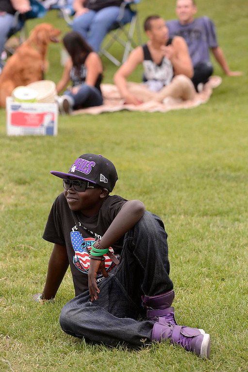 . Sudanese refugee Walter listens to Sam Childers speak during the Lifepoint Church\'s Picnic at Red Hill Community Park in Rancho Cucamonga May 5, 2013.   GABRIEL LUIS ACOSTA/STAFF PHOTOGRAPHER.