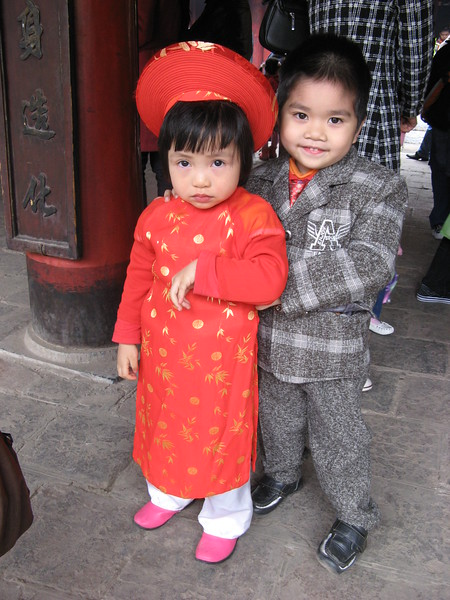 On this day of TET, people wear their best outfits out around town - Temple of Literature