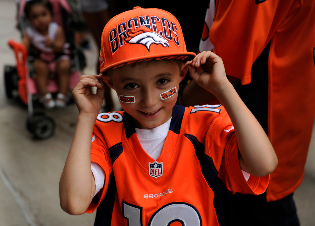 . DENVER, CO. - AUGUST 03: Elijah Martinez, age 6, showed off some of the new gear he just got to prove his authenticity as a fan. Denver Broncos fans lined up outside Sports Authority Field Saturday afternoon, August 3, 2013 before gates opened to watch practice.  Photo By Karl Gehring/The Denver Post