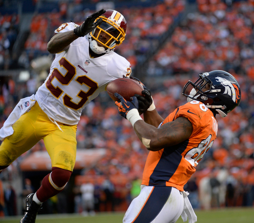 . Washington Redskins cornerback DeAngelo Hall (23) takes the ball away from Denver Broncos wide receiver Demaryius Thomas (88) for an interception during the fourth quarter. The Denver Broncos vs. the Washington Redskins at Sports Authority Field at Mile High in Denver on October 27, 2013. (Photo by Tim Rasmussen/The Denver Post)