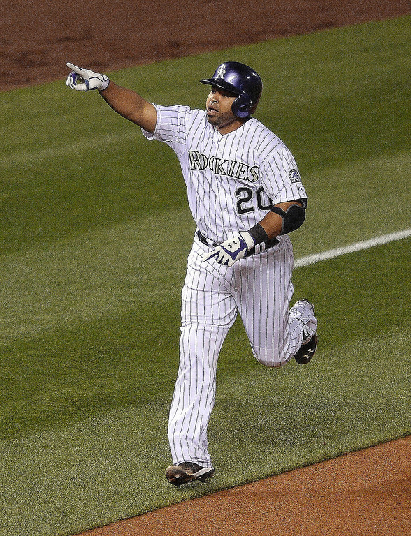 . Colorado\'s Wilin Rosario pointed to someone in the crowd following his game-equalizing home run in the sixth inning.   (Photo by Karl Gehring/The Denver Post)