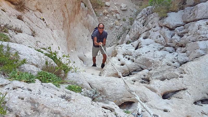 Rolf on the Cala Testos rope climb
