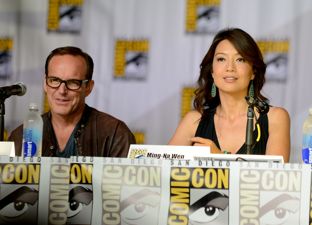 """. Clark Gregg, left, and Ming-Na Wen attend \""""Agent of S.H.I.E.L.D.\"""" panel on Day 3 of Comic-Con International on Friday, July 19, 2103, in San Diego. (Photo by Jordan Strauss/Invision/AP)"""