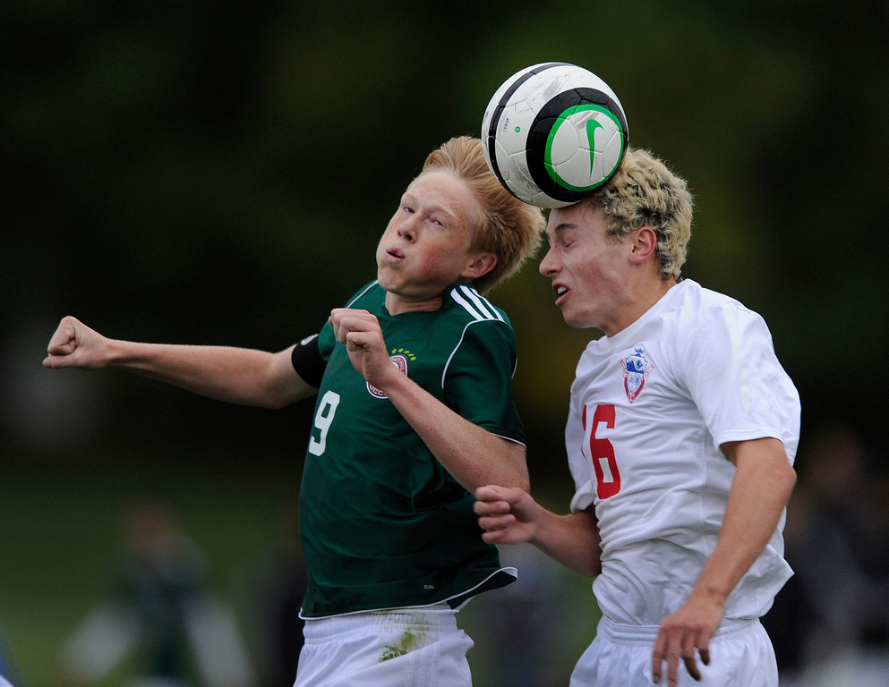 . GREENWOOD VILLAGE, CO. - OCTOBER 10: Smoky Hill senior midfielder Tyler Glenn (9) competed for a header with Bruin\'s defender Teddy Marchildon (16) in the second half. The Smoky Hill High School boy\'s soccer team shocked Cherry Creek 2-1 Thursday night, October 10, 2013.  Smoky Hill\'s lanky striker Walter Prince had both goals for the Buffalos. Photo By Karl Gehring/The Denver Post