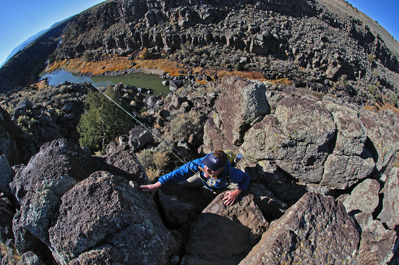 A fly fisherman climbs out of the Rio Grande canyon in northern New Mexico