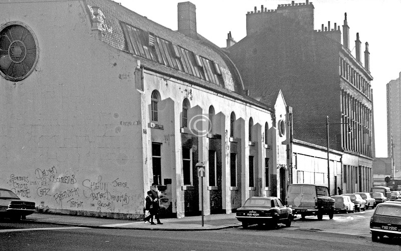 Oxford St and Buchan St  Built as a Baptist Church (mid 19th century?), around 1899 this became the Chevra Kadisha Synagogue,  merging in the 1950s with the  Beth Jacob Synagogue from Abbotsford Place..    November 1973