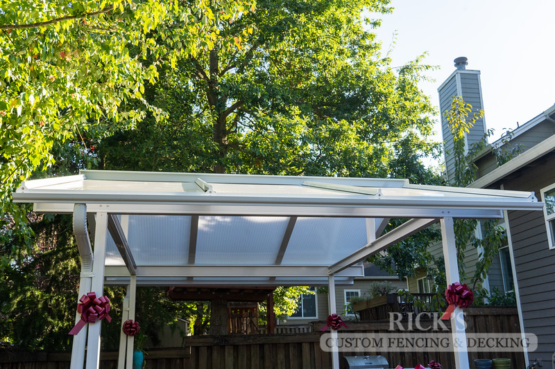 The building of one of our Acrilyte Patio Covers, made from powder-coated aluminum and acrylic panels.