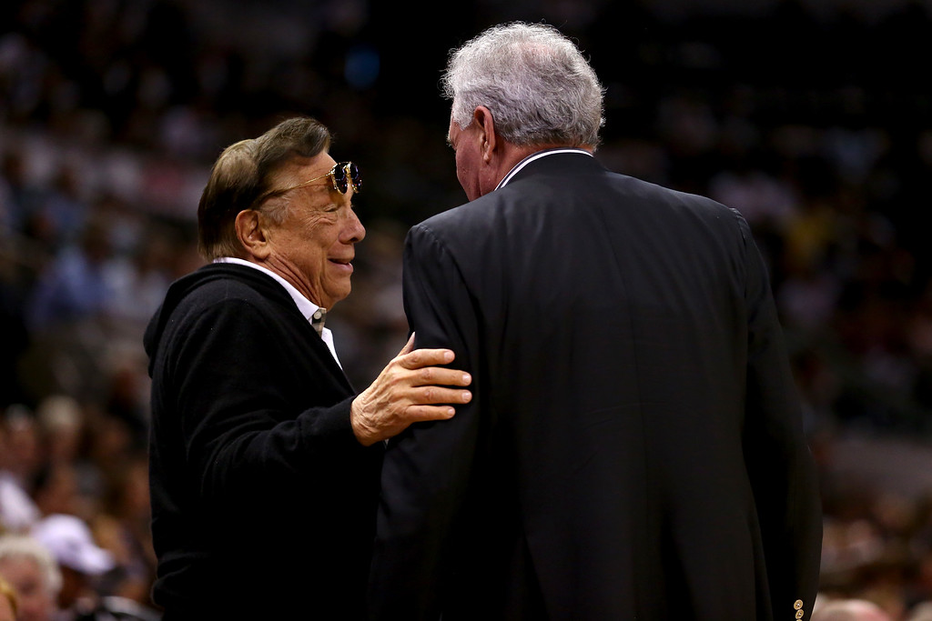 . SAN ANTONIO, TX - MAY 19:  (L-R) Team owner Donald Sterling of Los Angeles Clippers talks with team owner Peter Holt of the San Antonio Spurs as the SPurs host the Memphis Grizzlies during Game One of the Western Conference Finals of the 2013 NBA Playoffs at AT&T Center on May 19, 2013 in San Antonio, Texas.    (Photo by Ronald Martinez/Getty Images)