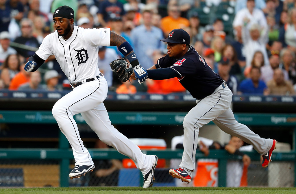 . Cleveland Indians third baseman Jose Ramirez, right, tags out Detroit Tigers\' Niko Goodrum who was running toward home plate in the third inning of a baseball game in Detroit, Friday, July 27, 2018. (AP Photo/Paul Sancya)