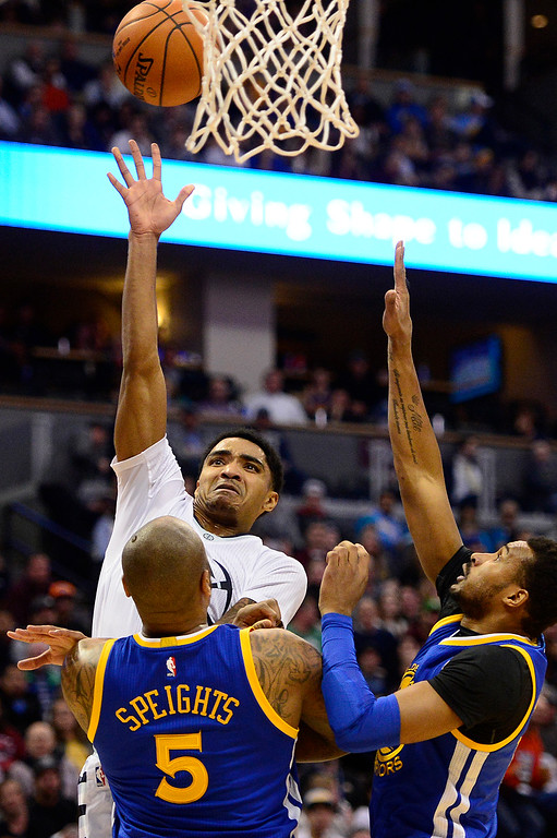 . DENVER, CO - JANUARY 13: Gary Harris (14) of the Denver Nuggets floats a shot over Marreese Speights (5) of the Golden State Warriors during the first half at the Pepsi Center on January 13, 2016 in Denver, Colorado.  (Photo by Brent Lewis/The Denver Post)