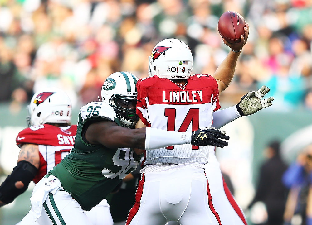 . Muhammad Wilkerson #96 of the New York Jets pressures  Ryan Lindley #14 of the Arizona Cardinals  during their game at at MetLife Stadium on December 2, 2012 in East Rutherford, New Jersey.  (Photo by Al Bello/Getty Images)