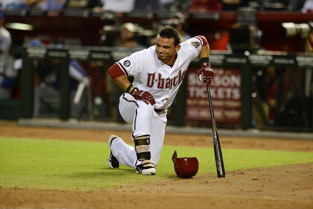 . PHOENIX, AZ - SEPTEMBER 16:  Gerardo Parra #8 of the Arizona Diamondbacks takes a knee after fouling a ball off his foot against the Los Angeles Dodgers at Chase Field on September 16, 2013 in Phoenix, Arizona.  (Photo by Norm Hall/Getty Images)