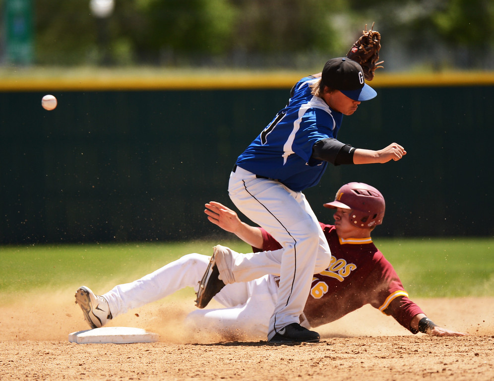 . DENVER, CO. - MAY 24 :Cole Anderson of Rocky Mountain High School (16) steals second base from Brooks Adams of Grandview High School (21) during semifinal round of 5A State Championships baseball game at All City Field. Denver, Colorado. May 24, 2013. Rocky Mountain won 8-6. (Photo By Hyoung Chang/The Denver Post)