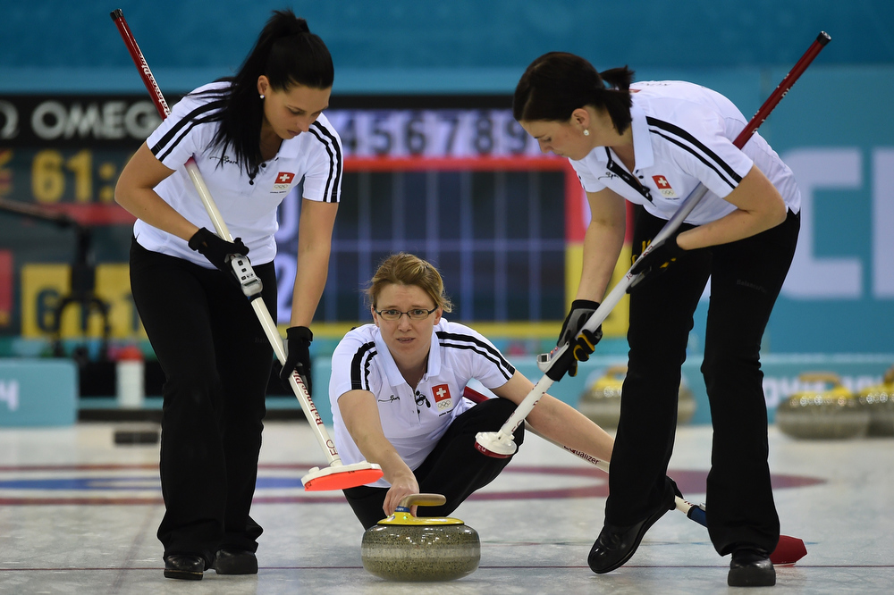 . Switzerland\'s Janine Greiner throws the stone during the Women\'s Curling Bronze Medal Game between Great Britain and Switzerland at the Ice Cube Curling Center during the Sochi Winter Olympics on February 20, 2014.  DAMIEN MEYER/AFP/Getty Images