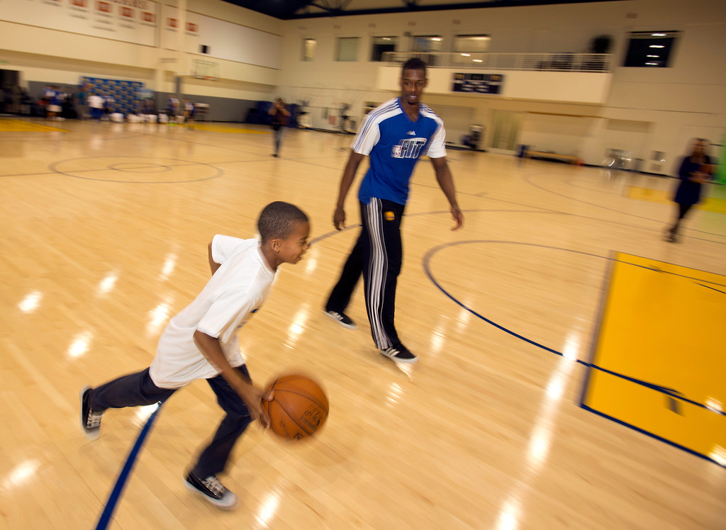 . Golden State Warriors forward Harrison Barnes, right, engages in a little one-on-one with nine-year-old Jesse Sexton of Oakland, Calif., during a basketball clinic at the Warriors practice facility in downtown Oakland, Wednesday, Jan. 30, 2013. The Warriors and Kaiser Permanente hosted the event as part of the NBA FIT Live Healthy Week. (D. Ross Cameron/Staff)