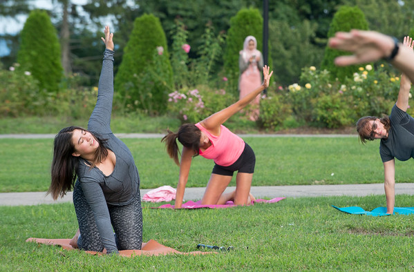 08/27/19 Wesley Bunnell | Staff Yoga in the Park is holding their last week of summer session classes with fall sessions slated to start in September through October. The program was put together by Kelly Murphy from Samatva Wellness in Berlin, the NB Parks and Recreation Department and the New Britain Health Department. Instructor Jocelyn Rivera, L, leads the class.