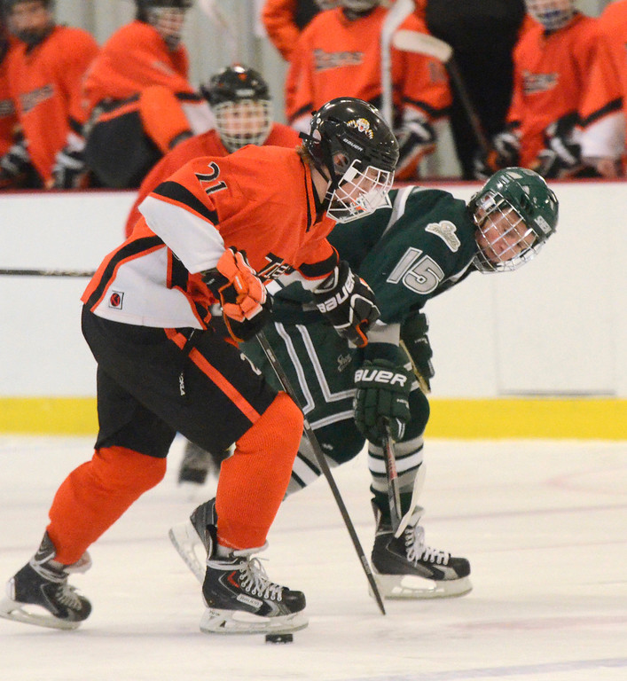 . Ed Burke - The Saratogian 12/07/13 Shen\'s Marvin Tucker reaches for the puck past Mammaroneck\'s Ryan LeBlanc during Saturday\'s action in the Don Kauth Memorial Tournament at Saratoga Springs Ice Rink.