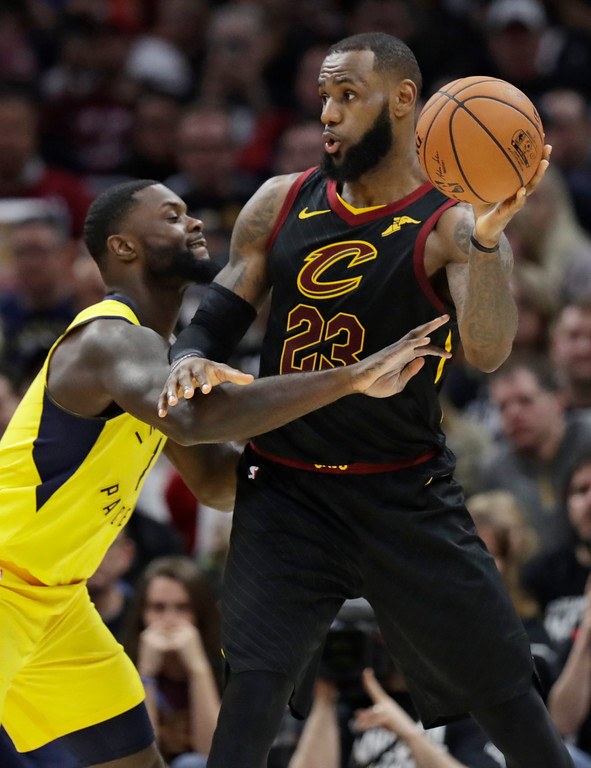 . Cleveland Cavaliers\' LeBron James (23) looks to pass against Indiana Pacers\' Lance Stephenson (1) in the second half of Game 1 of an NBA basketball first-round playoff series, Sunday, April 15, 2018, in Cleveland. (AP Photo/Tony Dejak)