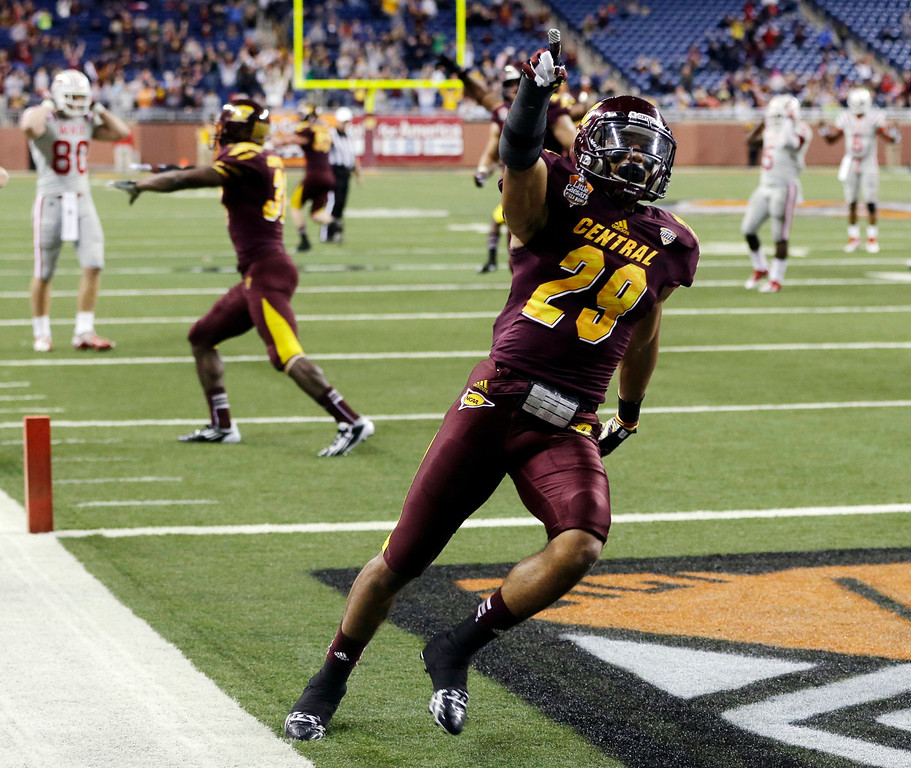 . Central Michigan defensive back Jarret Chapman (29) acknowledges the crowd after Western Kentucky tight end Jack Doyle missed a fourth-down catch during the final minute of the fourth quarter of the Little Caesars Pizza Bowl NCAA college football game at Ford Field in Detroit, Wednesday, Dec. 26, 2012. Central Michigan won 24-21. (AP Photo/Carlos Osorio)