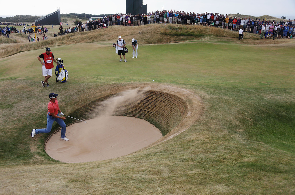 . Henrik Stenson of Sweden hits out of the bunker on the 13th during the final round of the 142nd Open Championship at Muirfield on July 21, 2013 in Gullane, Scotland.  (Photo by Rob Carr/Getty Images)