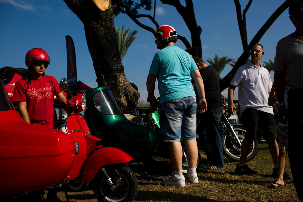 ". People park their antique scooters during the 31st annual ""Five Club\"" car collectors\' meeting in Ramat Gan, Israel, Friday, Oct. 6, 2017. Each weekend, at Israeli gas stations and parking lots and parks, car collectors gather with their beauties _ and take a step back in time. (AP Photo/Oded Balilty)"