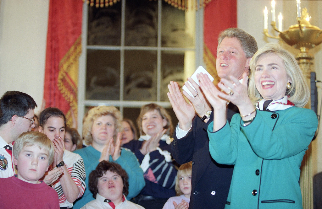 . President Bill Clinton and Mrs. Hillary Clinton applaud the Children�s Choir of Maine after their performance at the White House in Washington  Thursday, Jan. 21, 1993. The choir was scheduled to perform in the Inaugural Parade on Wednesday along with the Sounds of Silence singing group from Ohio, seen behind, but was unable to when their float broke down before the parade started. (AP Photo/Wilfredo Lee)