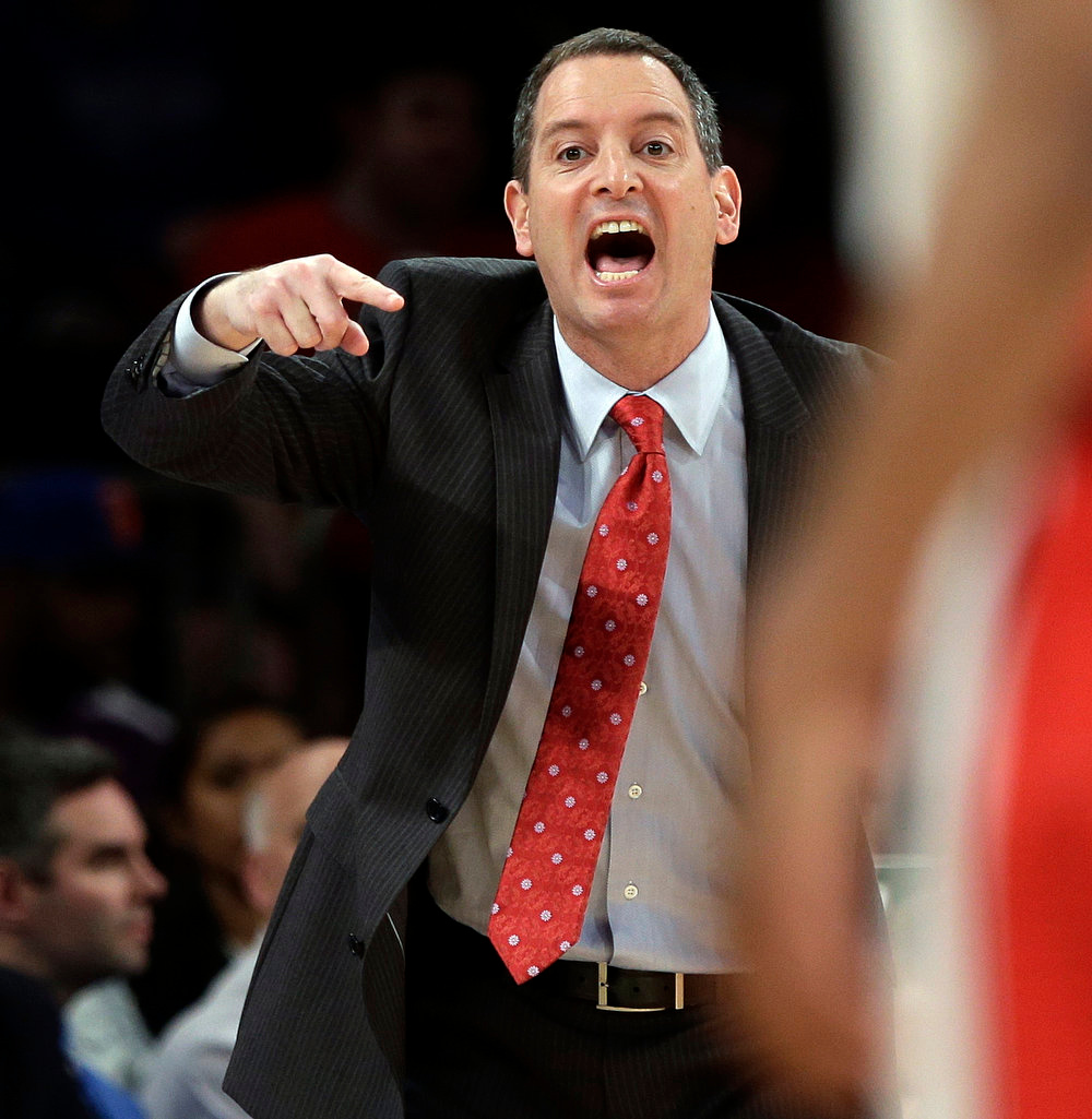 . Rutgers head coach Mike Rice calls out to his team during the first half of an NCAA college basketball game against DePaul at the Big East Conference tournament, Tuesday, March 12, 2013, in New York. (AP Photo/Frank Franklin II)