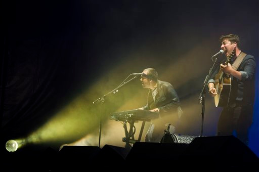 Description of . Mumford & Sons band members, from left, Ben Lovett and Marcus Mumford perform on Wednesday, Aug. 28, 2013 at the West Side Tennis Club in the Forest Hills neighborhood of the Queens borough of New York. (Photo by Charles Sykes/Invision/AP)