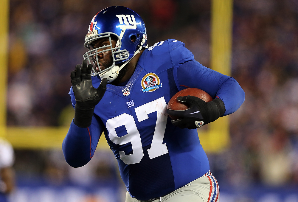 Description of . Linval Joseph #97 of the New York Giants recovers a fumble and carries the ball in the first quarter against the New Orleans Saints on December 9, 2012 at MetLife Stadium in East Rutherford, New Jersey.  (Photo by Elsa/Getty Images)