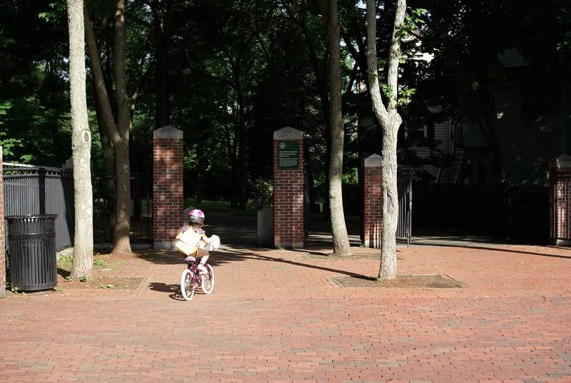 Guen rides onto the bikepath.