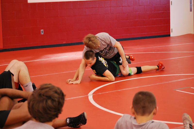 Ken-Chertow-Wrestling-Camp-at-Lutheran-West-2x-NCAA-Champion-Joe-Kemmerer-with-LWs-Tim-Mec-9.jpg